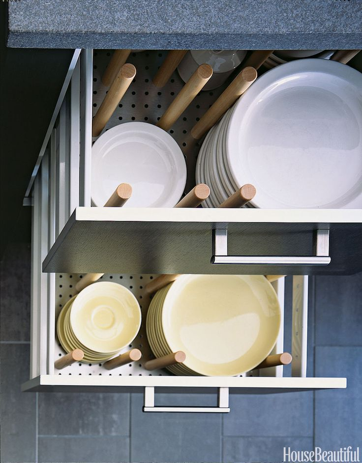 """""""Crockery drawers mean you're not on your toes, straining to reach a stack of heavy china,"""" Julie Stevenson says of her sleek, streamlined kitchen designed by Alexander Adducci in Lake Bluff, Illinois. The drawers are outfitted with movable pegs so that it's easy to accommodate various size dishes.   - HouseBeautiful.com"""