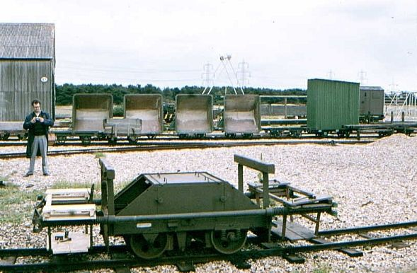 Lydd ranges 2ft gauge railway yard showing a target trolley complete with buffer beams and mounts for targets. Behind are some of the railwa...