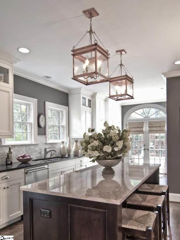 Traditional kitchen design also kitchen island popular granite colors and antique lantern style and traditional wooden stools with plait accent also white