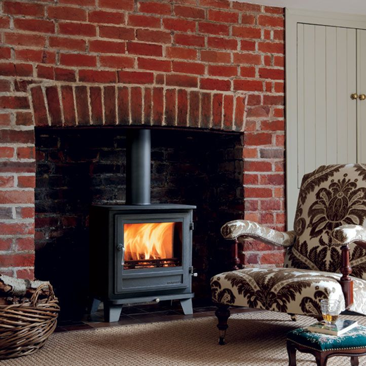 Wood burning stove with brick fireplace