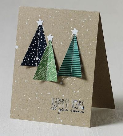 handmade Christmas card ...triangle fir trees from scrapbooking paper attached with a machine sewn line ... kraft bas witha splattering of white paint ... mod graphic look ...