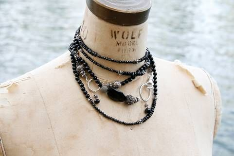 Rope of onyx mixed with silver beads and accent stones, wrapped into a choker.