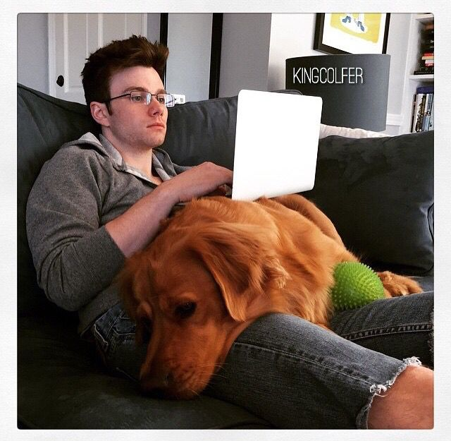 chris colfer with his dog, cooper! while writing tlos5 ❤️