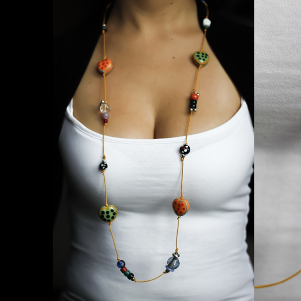 This cutie necklace is made from lots of ceramic and glass beads and  yellow leather string.