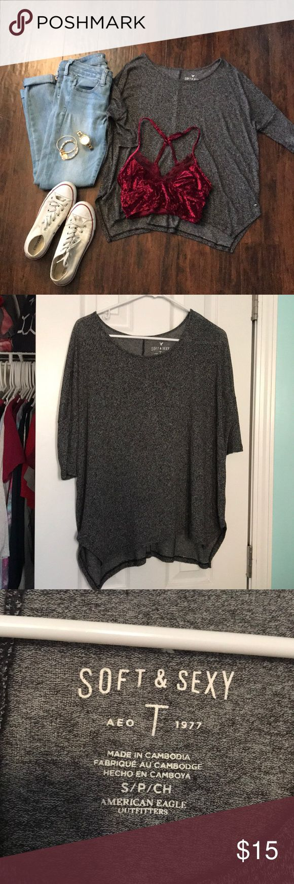 BOGO 1/2 OFF Slouchy grey 3/4 sleeve top Dark grey slouchy top, super soft, looks super cute paired with a bralette, gently used & in great condition ✨make an offer!✨feel free to comment if you have any questions 😊 ‼️ALL LISTINGS BUY ONE GET ONE HALF OFF❗️(of the two items, the less expensive item will be half off) just make a bundle and I'll re-price‼️ American Eagle Outfitters Tops Tees - Short Sleeve