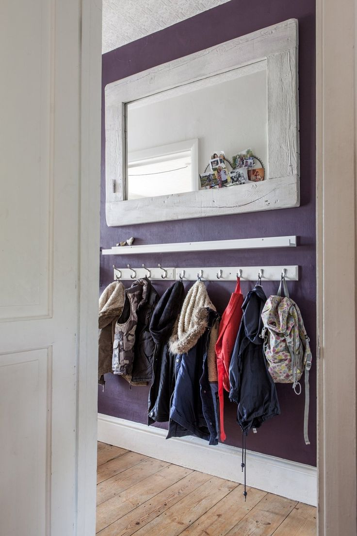 The very shallow little ledge shelf is a nice idea for a narrow hallway. The hooks hung low underneath work well for bags and jackets.