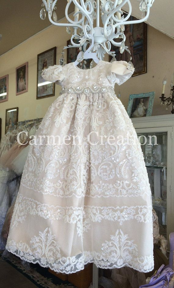 Our My Lady Baptism Gown is one of our newest items. It is ready to ship. Made in fine taffeta, chantue and french lace. Dress features full beaded lace, pearl/rhinestone buttons in the back. The skirt also features an open panel helping carry the baby more easily also helping the baptism gown stand out. Other features include Rhinestone waist decoration, rhinestones on cap sleeves and is fully lined for comfort. Great for someone looking for a one of a kind piece. Never mass produced. Made…