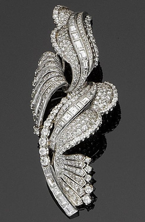A diamond spray brooch, circa 1965  Set with graduating ribbons of brilliant, baguette and single-cut diamonds, diamonds approximately 7.00 carats total. FABULOUS