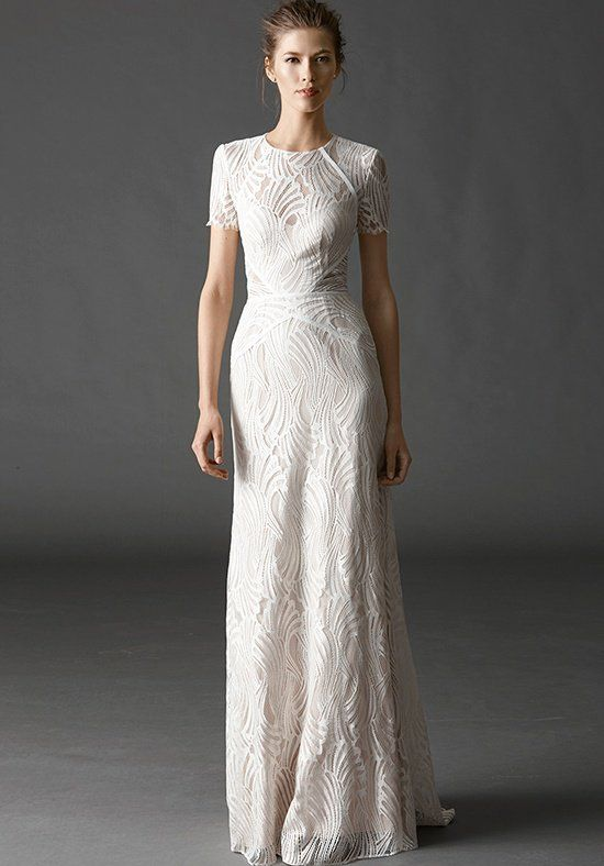 This short sleeve sheath is for our modern bride, featuring an illusion neckline in our Pascal Lace. Puddle Train.