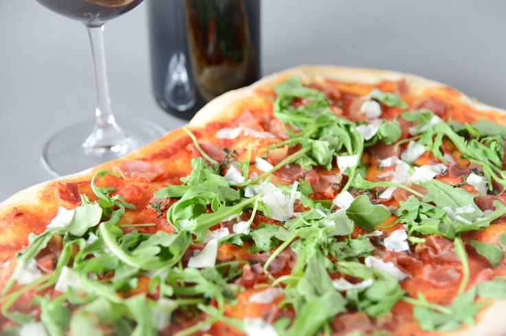 Our delicious Margherita Pizza with house made tomato sauce, bocconcini cheese, fresh basil, olive oil, oregano, balsamic reduction and sea salt.