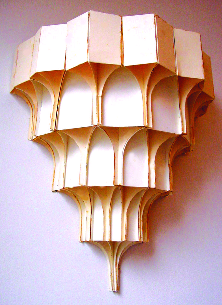 A cardboard muqarnas model I made several years ago. I made various different triangular vertical sections and glued them together. Islamic geometric design