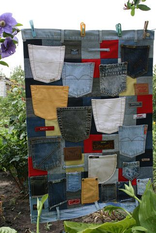 Got Jeans Pockets? ~ make a wall hanging!  I may even make one and arrange the pockets in line and use it as a wall hanging organizer to hold my small items?