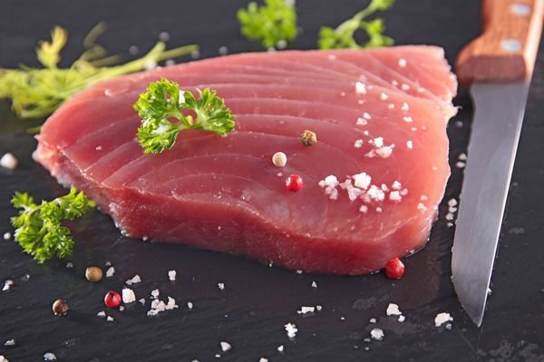 Losing belly fat is easier when you avoid these unhealthy and fattening types of fish like tilapia and Atlantic salmon.