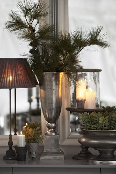 Home decor details. This makes me think of Christmas. I like the detail with the simple spruce in the vase. I will definitely do this for Christmas.