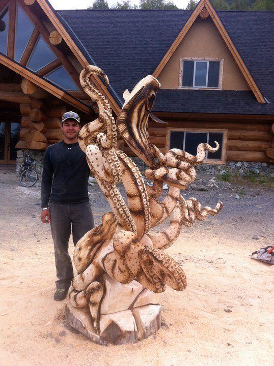 Jordan wood carvings sinous catch an octupus fishing