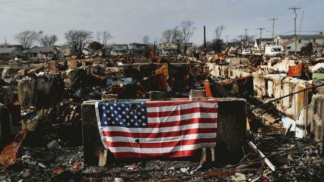 Patriotic Courage ~ An American flag displayed by residents of the Breezy Point neighborhood of  Queens, New York City whose 111 homes were destroyed by fire during Hurricane Sandy ~ December 4, 2012 by Spencer Platt/Getty Images