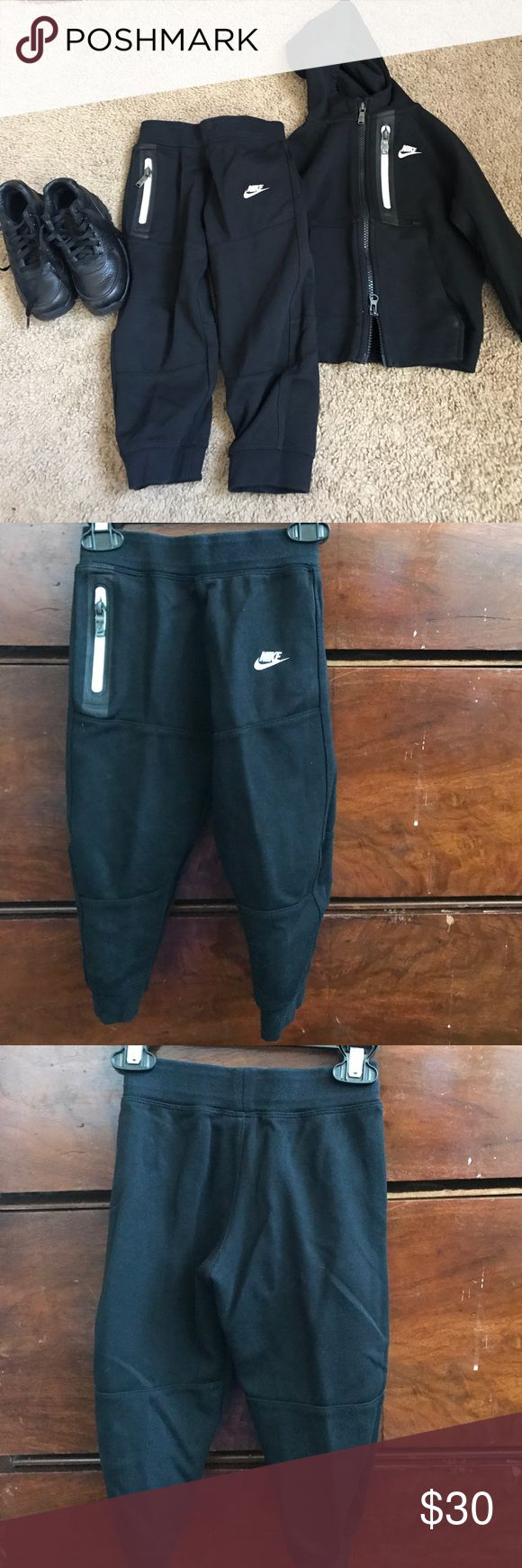 Nike sweats suit ..... WORN ONCE‼️‼️‼️ Black sweats suits with white detail , nice and stylish Nike Matching Sets
