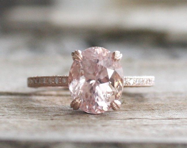 Love this oval-shaped pink diamond engagement ring.