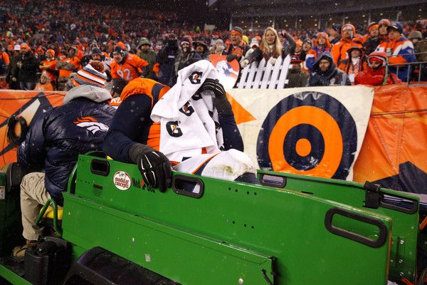 Nose tackle Sylvester Williams #92 of the Denver Broncos is carted off of the field after an injury against the New England Patriots at Sports Authority Field at Mile High on November 29, 2015 in Denver, Colorado.