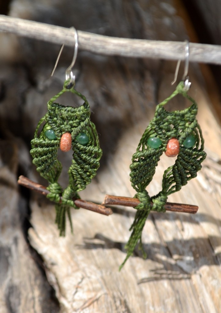 Macrame Owl Earrings  $65     The owls' eyes are Jade stones and the nose is a disc-shaped Jasper.     The macrame owls perch on twigs that were collected in our neighborhood park.     The earring wires are made from 950 silver, which is a purer silver than Sterling.
