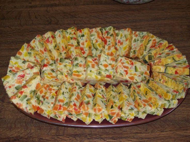 courgette, carotte, poivron rouge, oignon, oeuf, crême fraîche, semoule, gruyère râpé, persil, beurre, muscade, Sel, Poivre