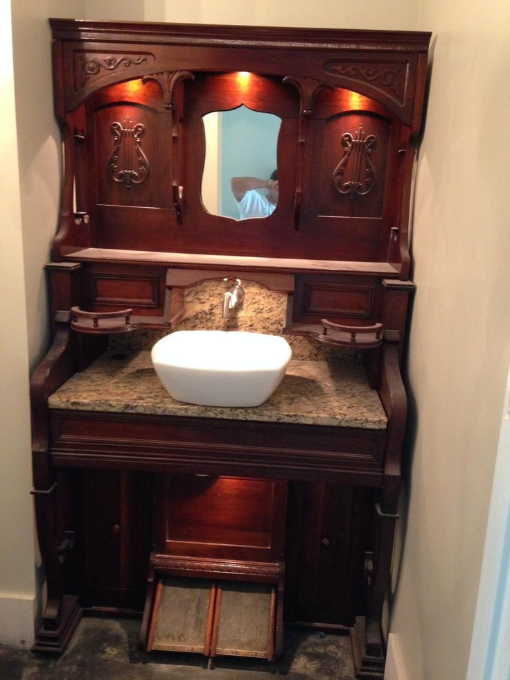 repurposed antique furniture. antique pump organ becomes a bathroom vanity by replacing keyboard with marble the pedals control repurposed furniture
