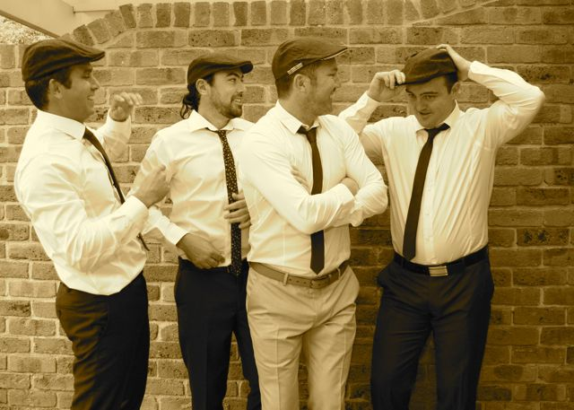 The boys getting ready for the ceremony, the hats were a super cool touch to this vintage inspired wedding