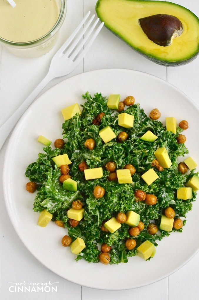 A nutritious Caesar kale salad made with avocado and crispy chickpeas (as croutons!) that tastes delicious! Dairy free and vegan! Find the recipe on NotEnoughCinnamon.com
