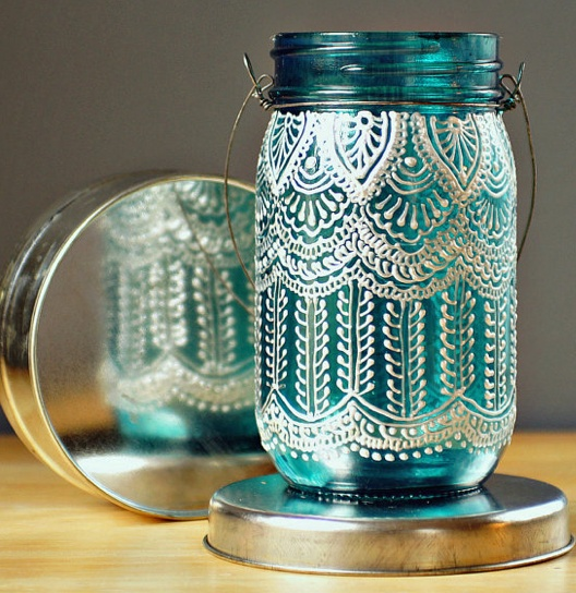 Hand painted jars - stunning, think they are by LIT decor. DIY with a very fine icing applicator and some white paint. You can put a picture on the inside of the jar and trace it through to get your design perfect.