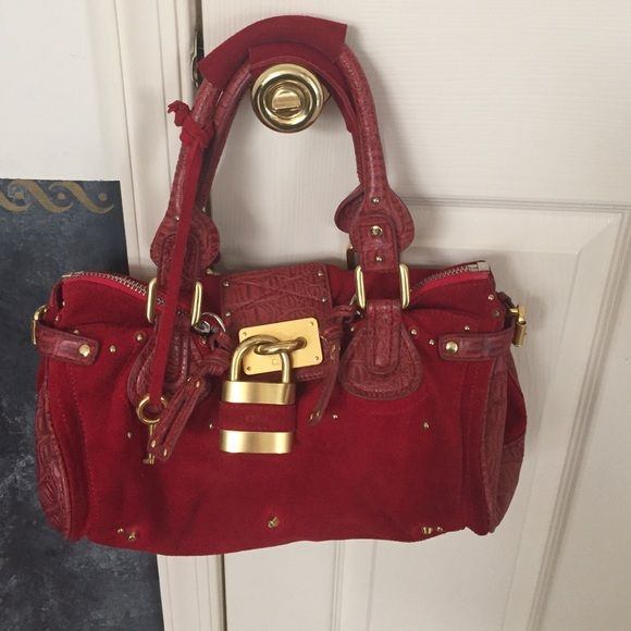 Chloe handbag Red leather and Swede handbag.  Lock has some wear on the gold but I feel the bag is still in great condition! Chloe Bags