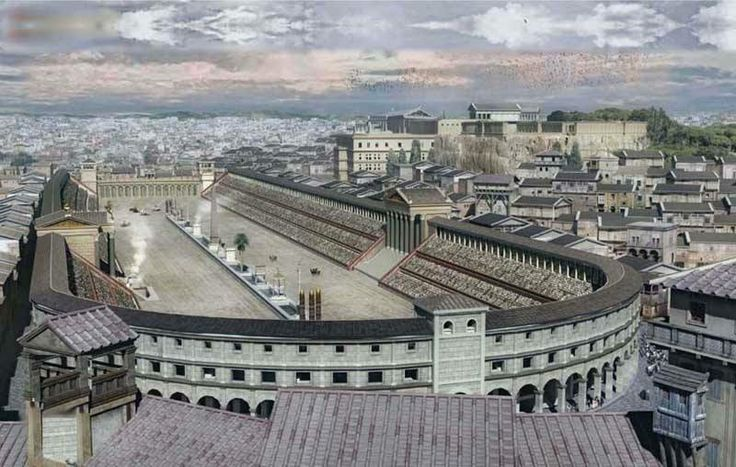 Digital reconstruction of the Circus Maximus, Rome. The performance space of the Roman circus was normally, despite its name, an oblong rectangle of two linear sections of race track, separated by a median strip running along the length of about two thirds the track, joined at one end with a semicircular section and at the other end with an undivided section of track closed (in most cases) by a distinctive starting gate known as the carceres, thereby creating a circuit for the races.