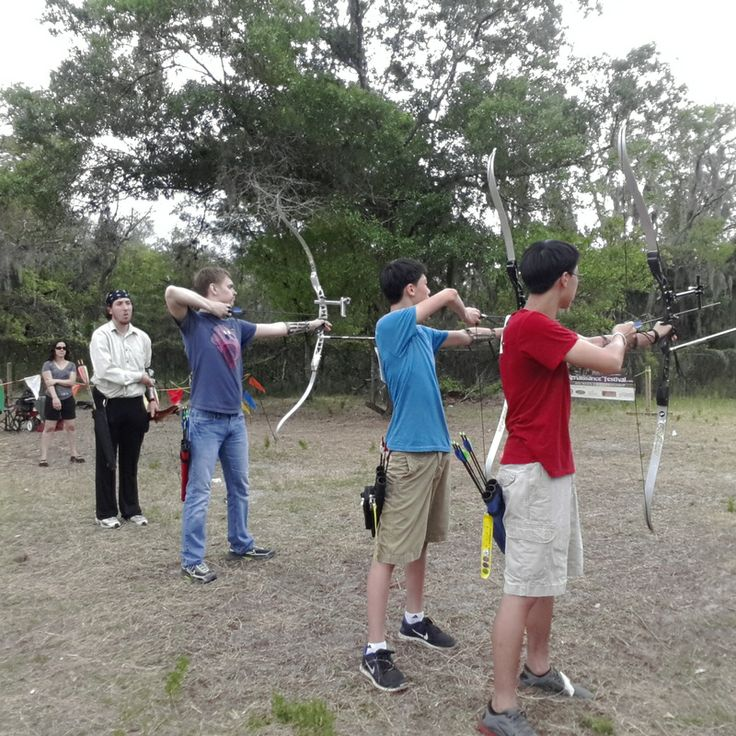 Kids shooting Olympic recurve bows