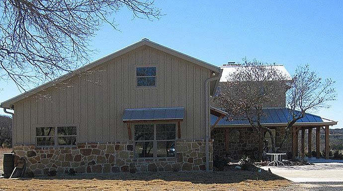 Lovely metal ranch home w wrap around porch in texas hq for Texas ranch house plans with porches
