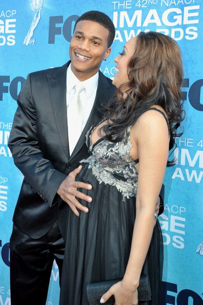 Actress Tia Mowry (L) and Husband Cory Hardrict arrive at the 42nd NAACP Image Awards held at The Shrine Auditorium on March 4, 2011 in Los Angeles, California.