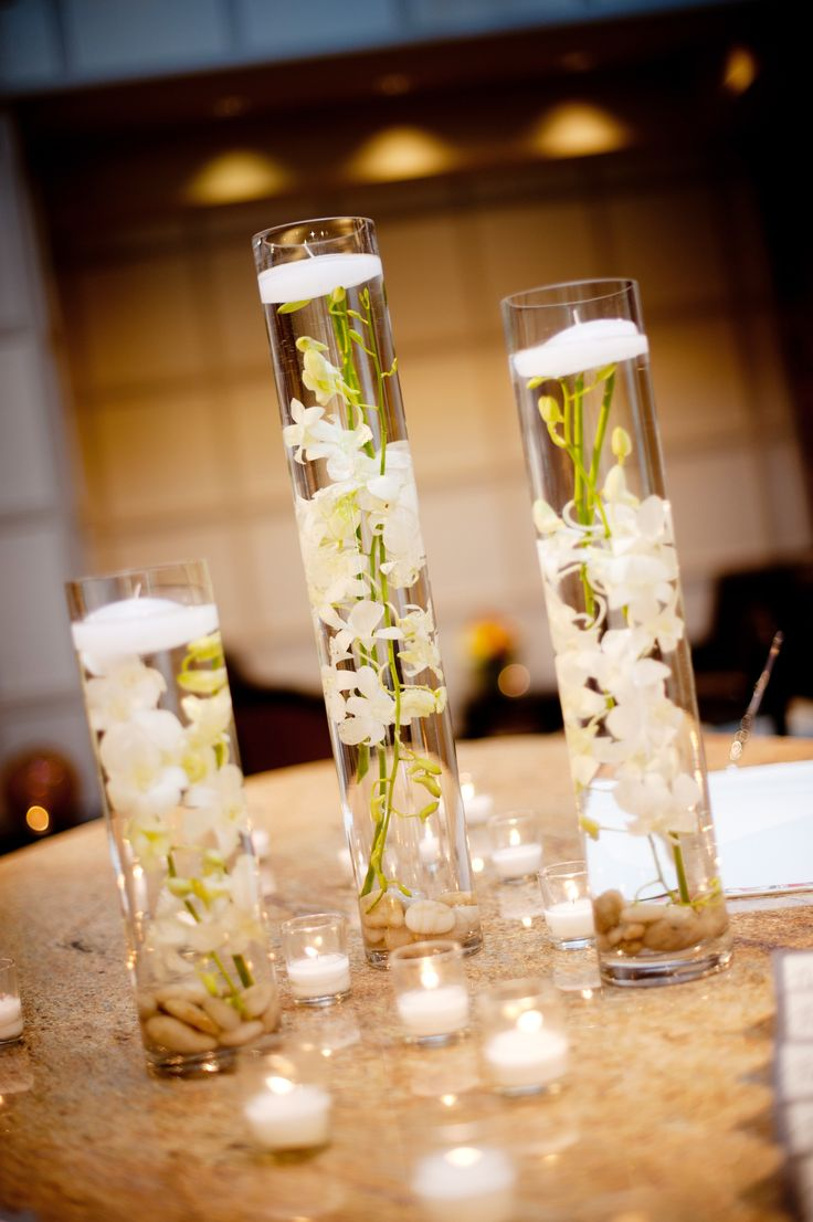 elegant real wedding with simple DIY details hurricane vases floating white orchids centerpieces