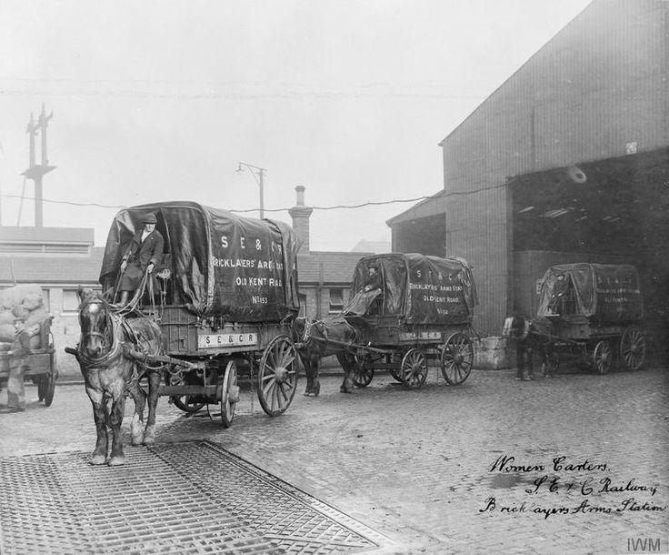 Women cart drivers emerging from their depot at The Bricklayers Arms on the Old Kent Road circa 1918.