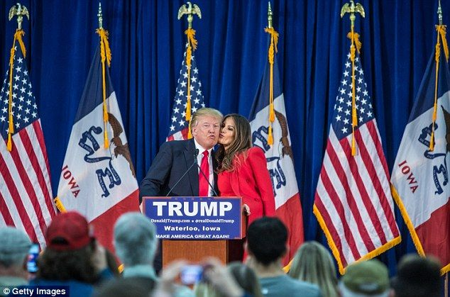 Trump's third wife Melania, a Slovenian-born former model, plants a peck on his cheek at the Ramada hotel in Waterloo today