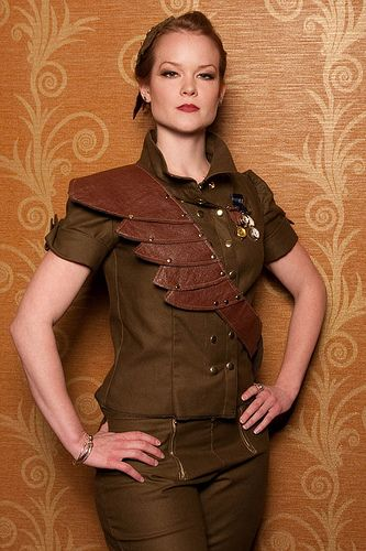 Short-Sleeved, Brown Military-Style Shirt with Fabulous Leather Sash Embellishment in a Lighter Brown & Matching Trousers.
