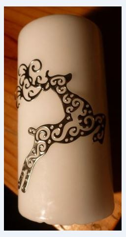 Filigree Reindeer on Candle.  Made by Caroline @ Pewter Concepts