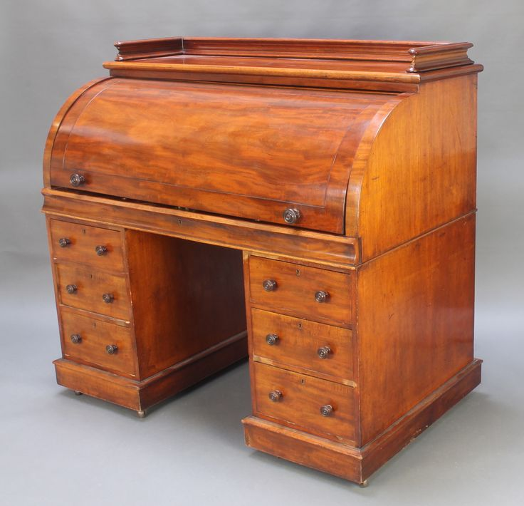 "Lot 1015, A Victorian mahogany cylinder bureau with three-quarter gallery the interior fitted pigeon holes and sliding writing surface above 6 long drawers 50""h x 53""w x 30""d est £200-300"