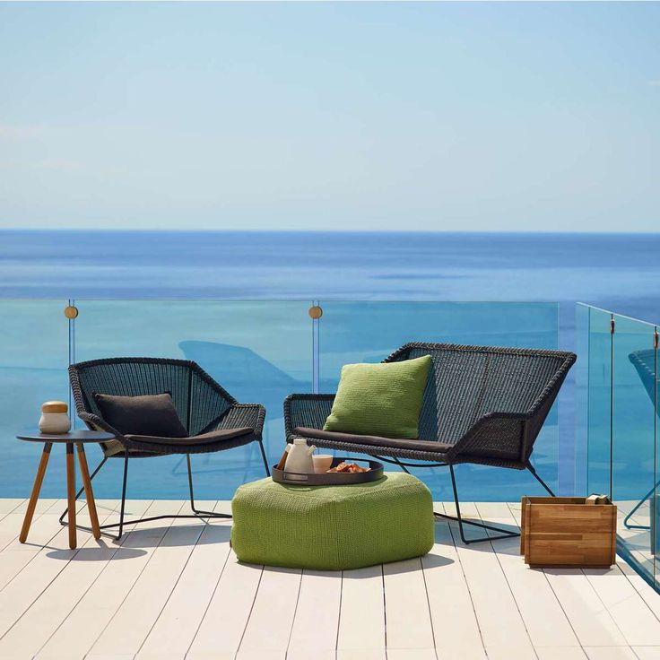Black pictured with the Breeze Lounge Chair, Breeze High Back Chair, and the Breeze Footstool (sold separately)
