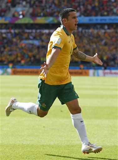 Australia's Tim Cahill celebrates after scoring his side's first goal during the group B World Cup soccer match between Australia and the Netherlands at the Estadio Beira-Rio in Porto Alegre, Brazil, Wednesday, June 18, 2014. (AP Photo/Wong Maye-E) ▼18Jun2014AP|Netherlands advance after 3-2 win over Australia http://bigstory.ap.org/article/netherlands-beat-australia-3-2-world-cup #Australia_Netherlands_group_B #Brazil2014