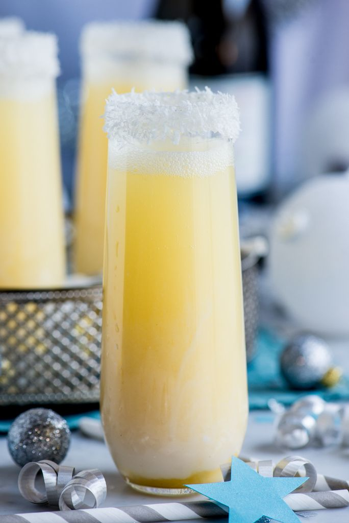 Pineapple Coconut Champagne Cocktail / Pineapple Juice + Coconut Juice Blend + Champagne or Prosecco +  Simple Syrup + Finely shredded coconut.