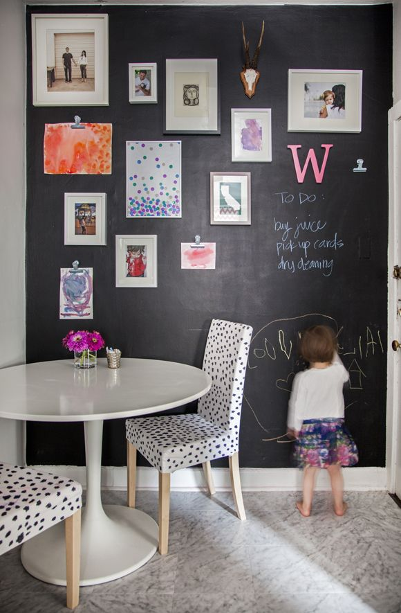 cute sitting area chairs are made from ikea chair covers and sharpie pen, black chalkboard wall with artwork hanging. cute way to decorate chalkboard wall rather than just with chalk...warmer homier feel Little Green Notebook