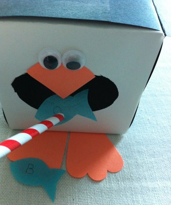ORAL MOTOR game! Use straw to place fish in the penguins mouth! Or feed little pellets with tweezers!!!   Visit pinterest.com/arktherapeutic for more #oralmotor therapy games