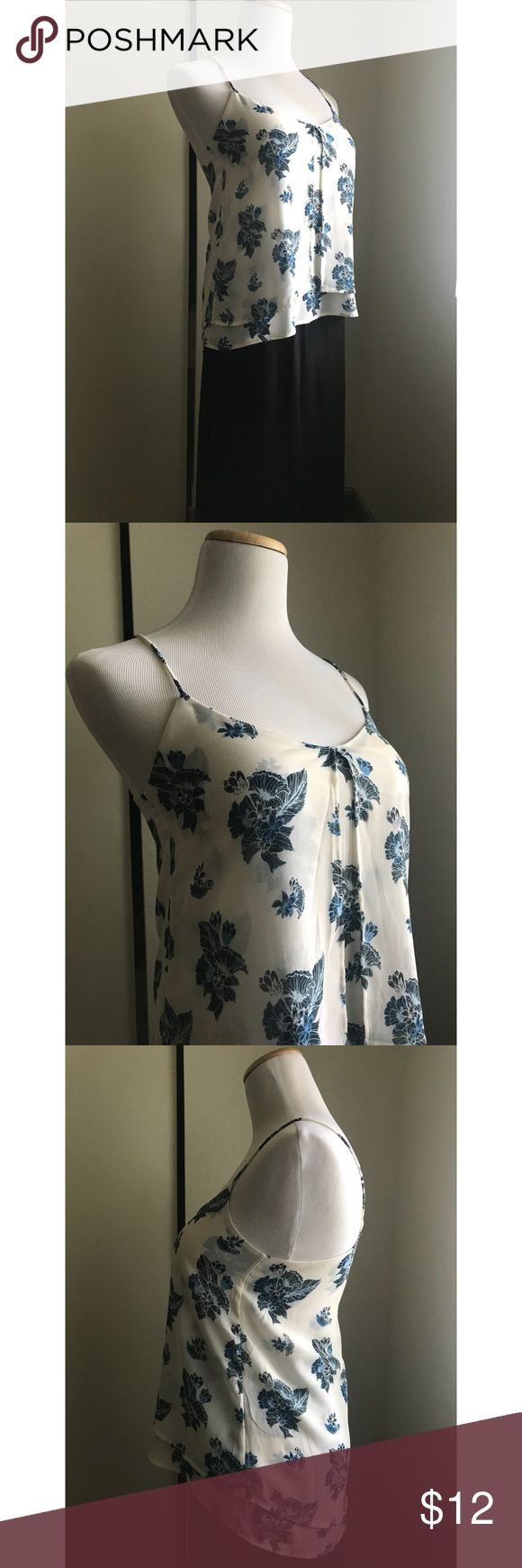 White & Blue Floral Cami White cami top with blue floral prints from H&M.  Perfect for The coming spring or summer ☀️  Used Size: 2 true to size Also comes in color: Olive  $12 each but negotiable if you buy the 2 😉  *Skirt also from H&M but not for sale H&M Tops Camisoles