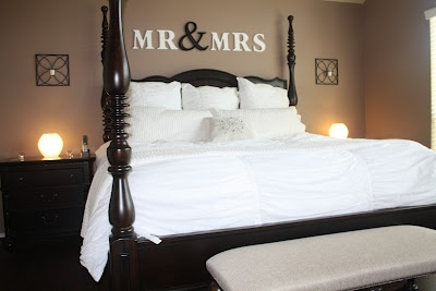 Mr & Mrs above the bed. Except i would frame the Mr & Mrs and add something under it