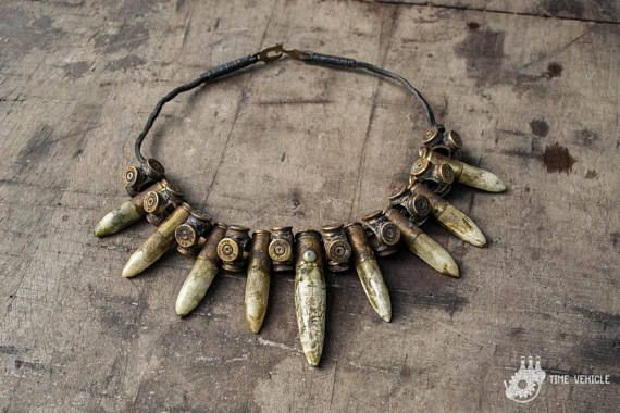 Post Apocalyptic Bones and Gun Shells Necklace - Wasteland Weekend Necklace - Dystopian Bib Necklace - Burning Man Costume Accessories  Designer of the project is Viola Sychowska, founder of Wasted Couture collective. Brass work is made by Konrad Radziszewski, member of Wasted Couture collective.  Those bones are authentic and has been repurposed (its eco friendly) which I think adds to the post apocalyptic beauty. All bones and animal products are ethically collected.  Following necklace…