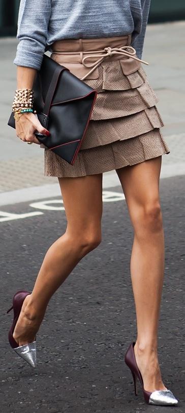 grey sweater + ruffled skirt + clutch + heels