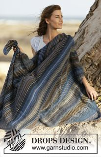 """Sandstorm - Knitted DROPS blanket in garter st with stripes in """"Delight"""". - Free pattern by DROPS Design"""